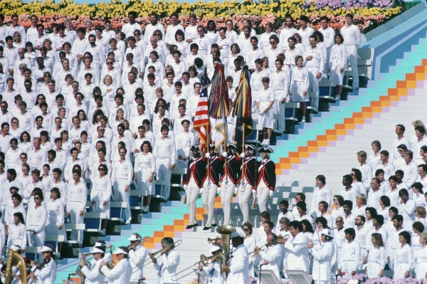 A color guard wearing Revolutionary War costumes participates in the opening ceremonies for the 1984 Olympics.